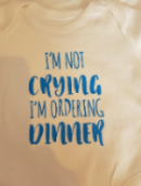 Baby bodysuit/romper not crying ordering dinner